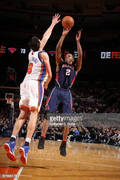 Joe Johnson of the Atlanta Hawks shoots against Danilo Gallinari of the New York Knicks on March 8, 2010 at Madison Square Garden in New York City....