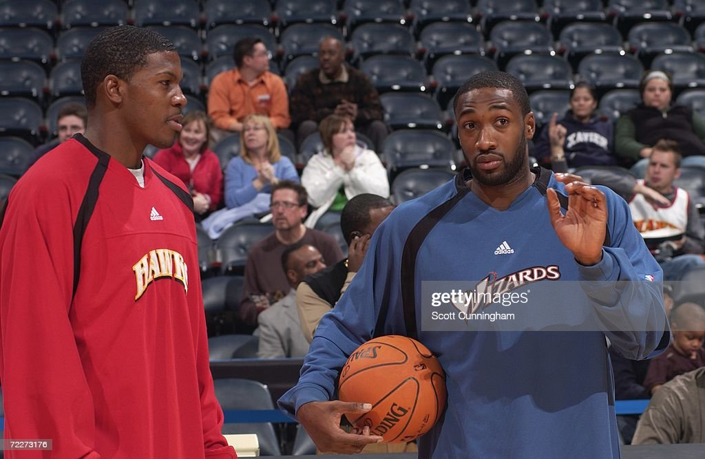 Joe Johnson #2 of the Atlanta Hawks talks with Gilbert Arenas #0 of the Washington Wizards prior to a preseason game at Philips Arena on October 23, 2006 in Atlanta, Georgia. The Wizards won 110-105.