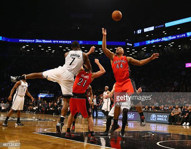 Joe Johnson of the Brooklyn Nets and Chuck Hayes of the Toronto Raptors go for a rebound in Game Four of the Eastern Conference Quarterfinals during...
