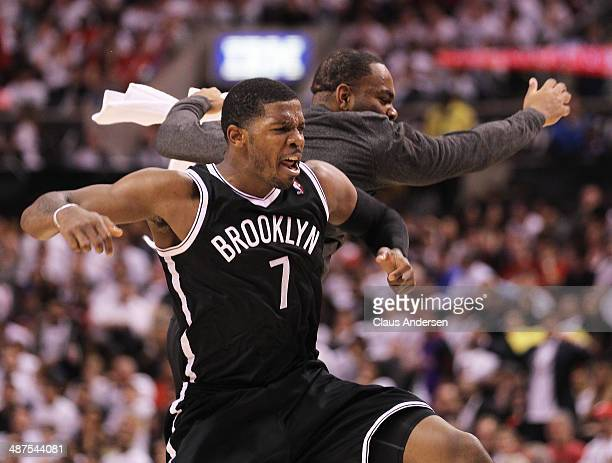 Joe Johnson of the Brooklyn Nets celebrates a big 3 pointer against the Toronto Raptors in Game Five of the NBA Eastern Conference Quarterfinals at...