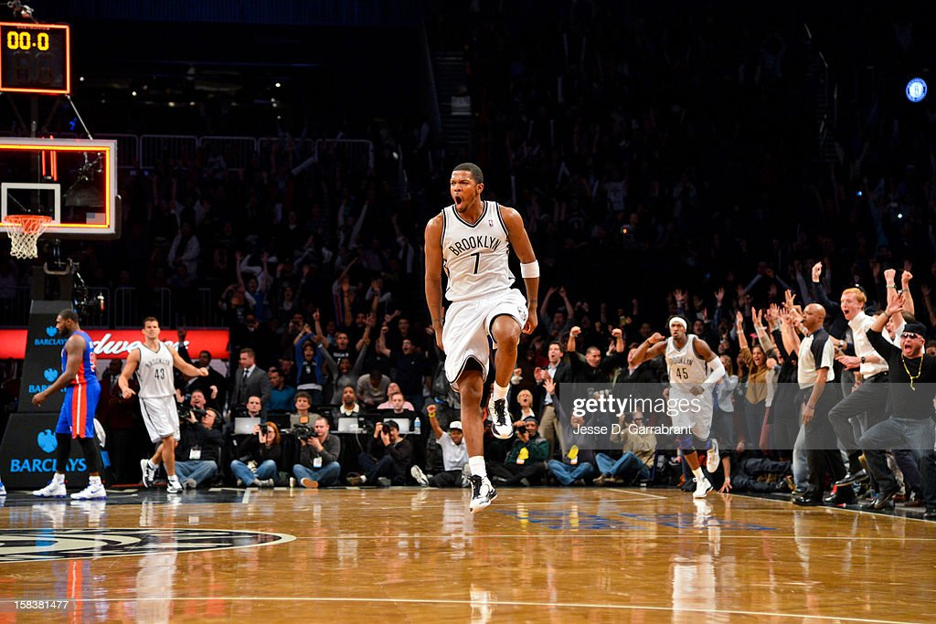 Joe Johnson #7 of the Brooklyn Nets celebrates after making the game-winning shot against the Detroit Pistons in double overtime at the Barclays Center on December 14, 2012 in the Brooklyn borough of New York City.