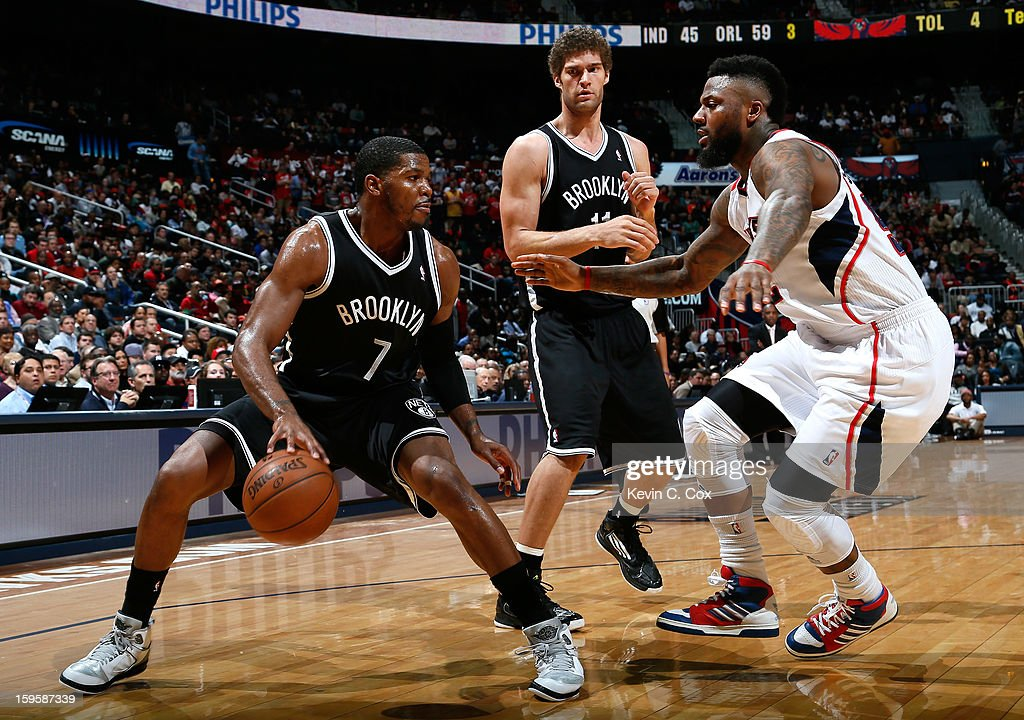 Joe Johnson #7 of the Brooklyn Nets drives against DeShawn Stevenson #92 of the Atlanta Hawks at Philips Arena on January 16, 2013 in Atlanta, Georgia.