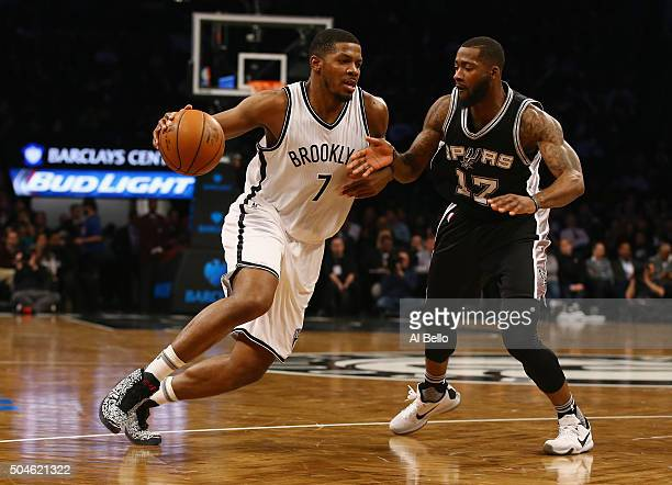 Joe Johnson of the Brooklyn Nets drives against Jonathon Simmons of the San Antonio Spurs during their game at the Barclays Center on January 11 2016...