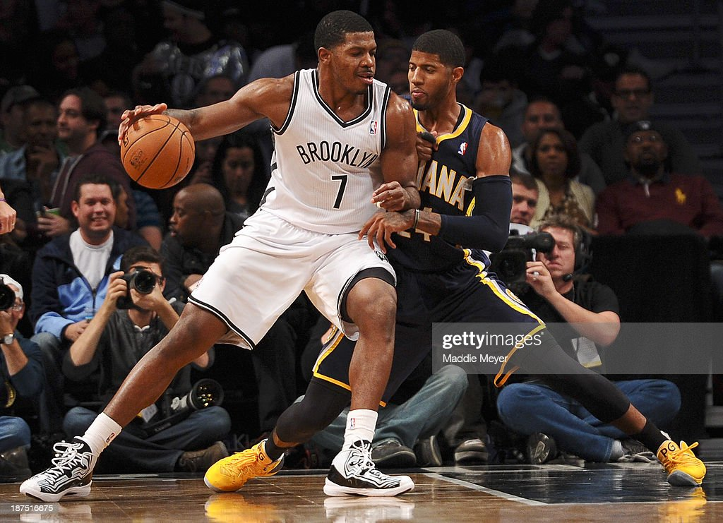 Joe Johnson #7 of the Brooklyn Nets drives against Paul George #24 of the Indiana Pacers at Barclays Center on November 9, 2013 in the Brooklyn borough of New York City. The Pacers defeat the Nets 96-91.