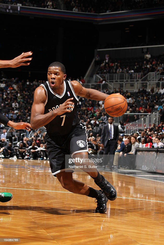 Joe Johnson #7 of the Brooklyn Nets drives against the Boston Celtics during a pre-season game on October 18, 2012 at the Barclays Center in the Brooklyn borough of New York City.