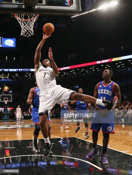 Joe Johnson of the Brooklyn Nets goes up and scores two against the Philadelphia 76ers at Barclays Center on December 23 2012 in the Brooklyn borough...