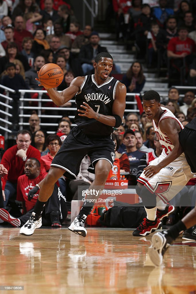 Joe Johnson #7 of the Brooklyn Nets handles the ball against Jimmy Butler #21 of the Chicago Bulls on December 15, 2012 at the United Center in Chicago, Illinois.