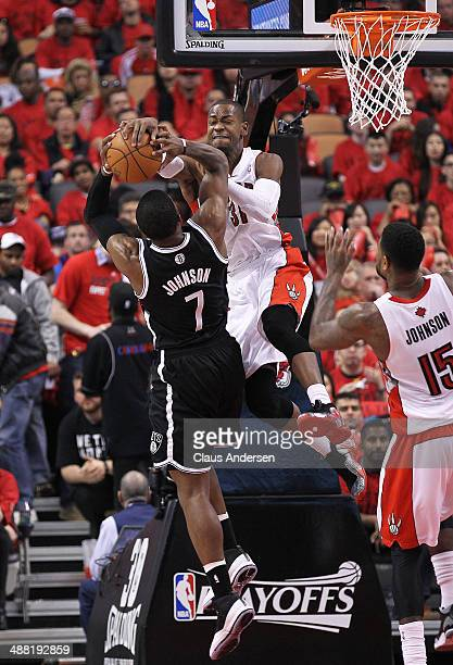 Joe Johnson of the Brooklyn Nets is denied by Terrence Ross of the Toronto Raptors in Game Seven of the NBA Eastern Conference Quarterfinals at the...