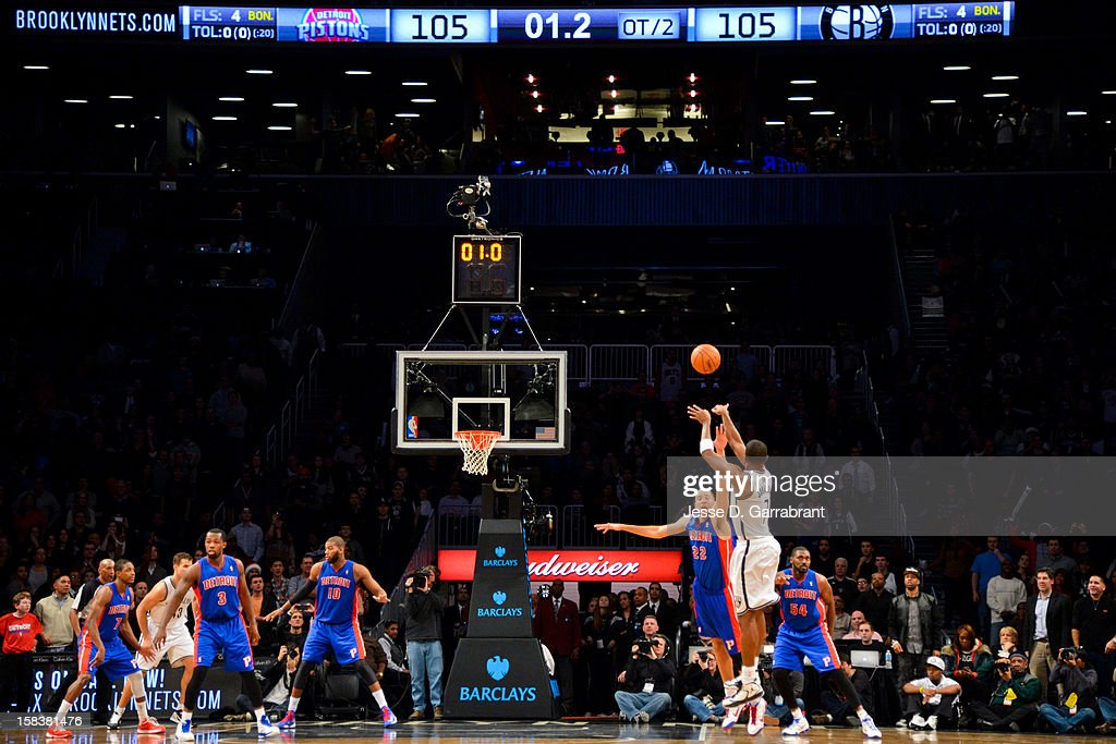 Joe Johnson #7 of the Brooklyn Nets makes the game-winning shot at the buzzer against Tayshaun Prince #22 of the Detroit Pistons in double overtime at the Barclays Center on December 14, 2012 in the Brooklyn borough of New York City.