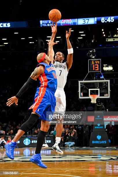 Joe Johnson of the Brooklyn Nets shoots against Corey Maggette of the Detroit Pistons at the Barclays Center on December 14 2012 in the Brooklyn...