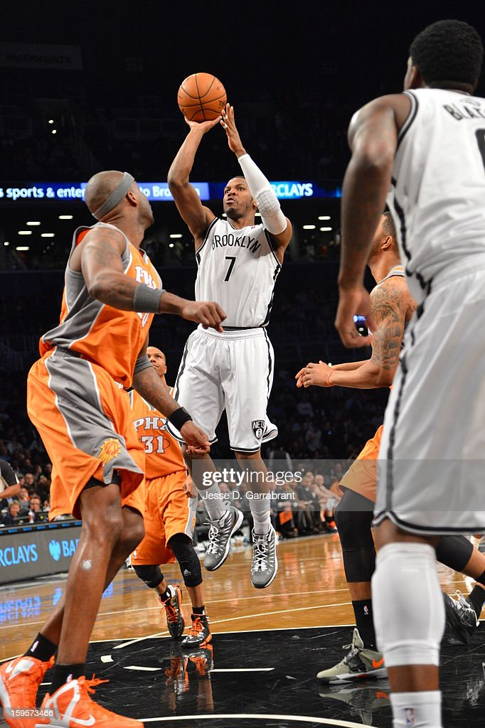 Joe Johnson #7 of the Brooklyn Nets takes a shot against the Phoenix Suns at the Barclays Center on January 11, 2013 in Brooklyn, New York.