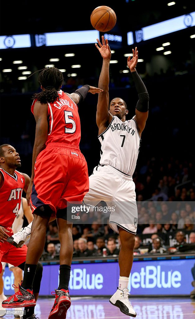 Joe Johnson #7 of the Brooklyn Nets takes a shot as DeMarre Carroll #5 of the Atlanta Hawks defends at the Barclays Center on January 6, 2014 in the Brooklyn borough of New York City.The Brooklyn Nets defeated the Atlanta Hawks 91-86.