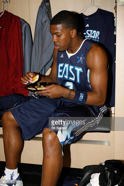 Joe Johnson of the Eastern Conference eats at his locker prior to the 58th NBA AllStar Game part of 2009 NBA AllStar Weekend at US Airways Center on...
