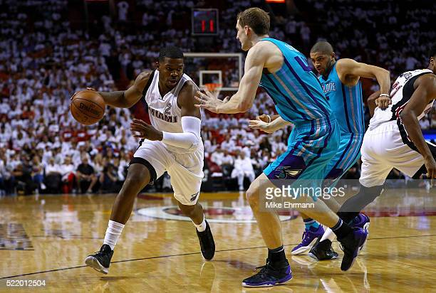 Joe Johnson of the Miami Heat drives on Cody Zeller of the Charlotte Hornets during Game One of the Eastern Conference Quarterfinals during the 2016...