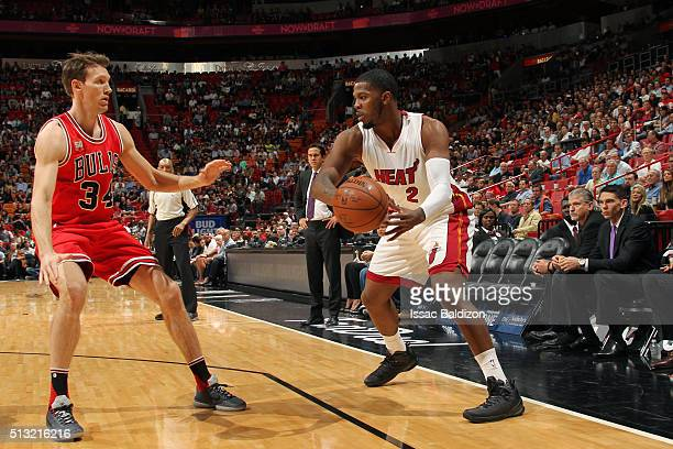Joe Johnson of the Miami Heat moves the ball against Mike Dunleavy of the Chicago Bulls during the game on March 1 2016 at American Airlines Arena in...