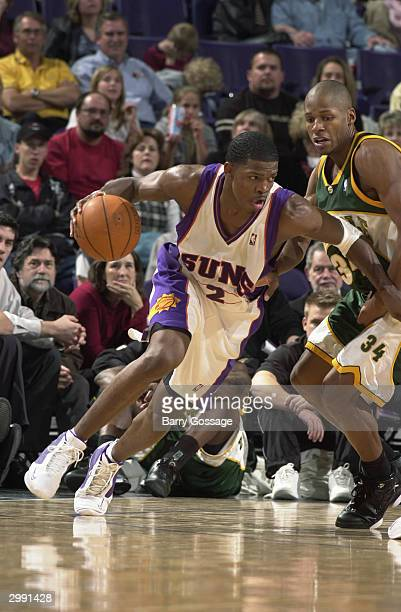 Joe Johnson of the Phoenix Suns drives against Ray Allen of the Seattle Sonics during the game at America West Arena on February 6 2004 in Phoenix...