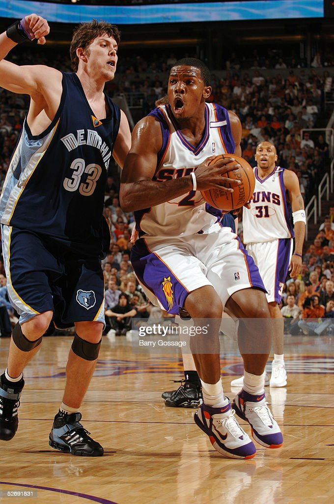 Joe Johnson #2 of the Phoenix Suns drives on Mike Miller #33 of the Memphis Grizzlies in Game one of the Western Conference Quarterfinals during the 2005 NBA Playoffs on April 24, 2005 at America West Arena in Phoenix, Arizona.