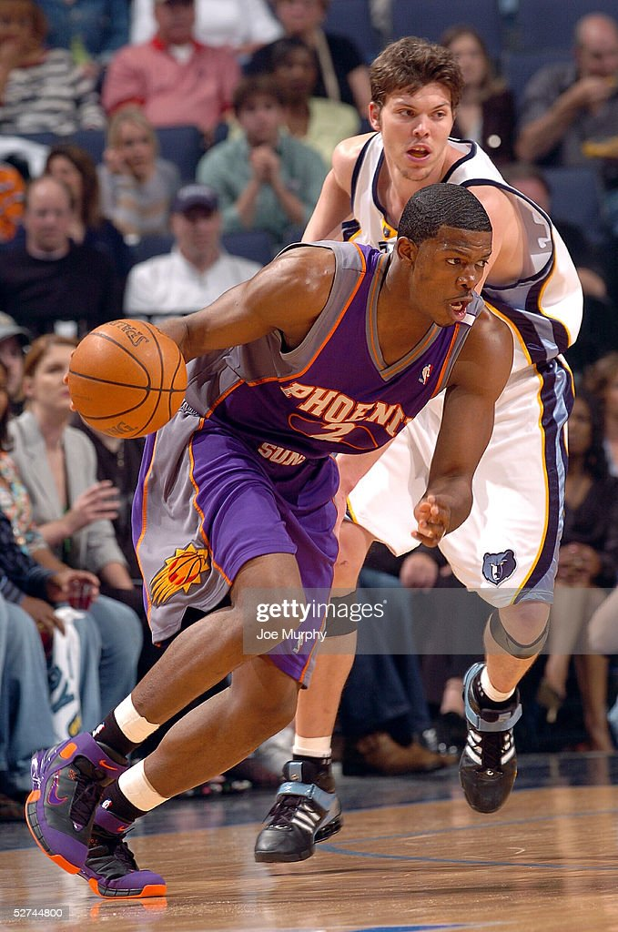 Joe Johnson #2 of the Phoenix Suns handles the ball against the defense of Mike Miller #33 of the Memphis Grizzlies in Game four of the Western Conference Quarterfinals during the 2005 NBA Playoffs on May 1, 2005 at FedExForum in Memphis, Tennessee.