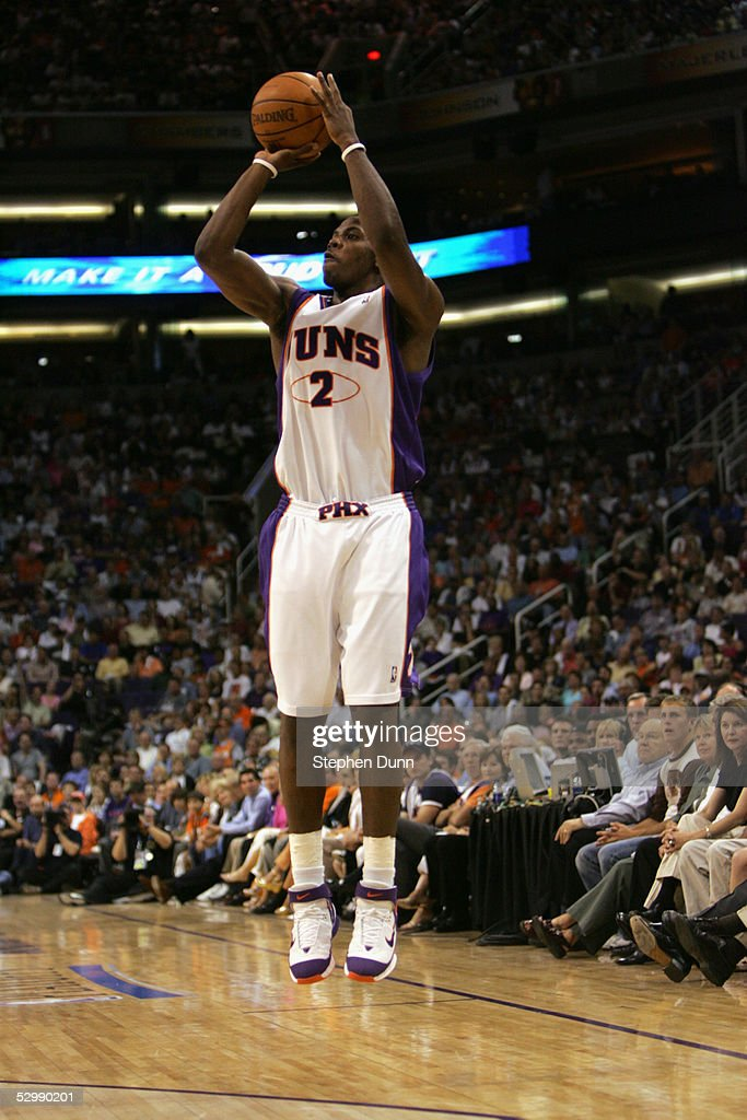 Joe Johnson #2 of the Phoenix Suns shoots against the Dallas Mavericks in Game one of the Western Conference Semifinals during the 2005 NBA Playoffs at America West Arena on May 9, 2005 in Phoenix, Arizona. The Suns won 127-102.