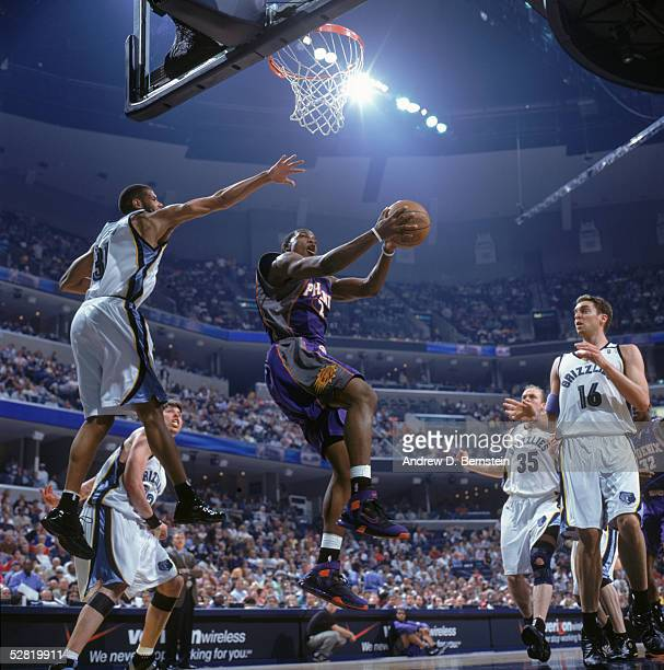 Joe Johnson of the Phoenix Suns takes the ball to the basket against Shane Battier of the Memphis Grizzlies in Game three of the Western Conference...