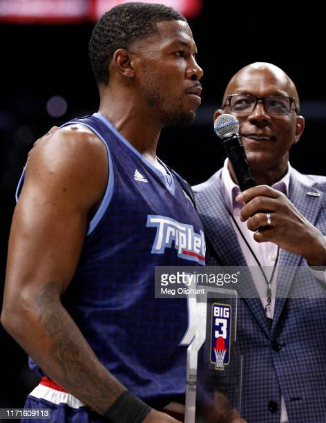 Joe Johnson of the Triplets is awarded the MVP trophy by BIG3 commissioner Clyde Drexler during the BIG3 Championship at Staples Center on September...