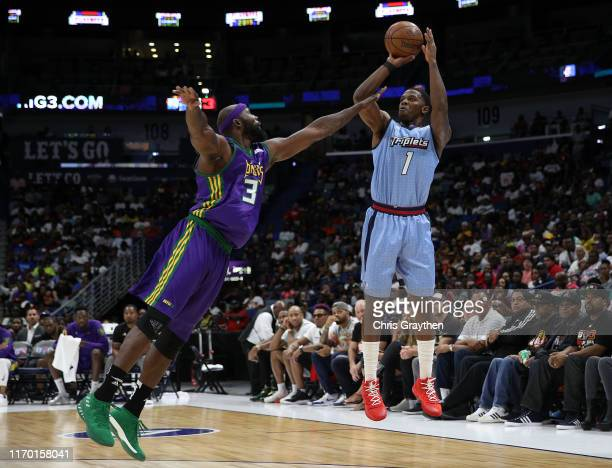 Joe Johnson of the Triplets takes a shot as Reggie Evans of the 3 Headed Monsters defends during the BIG3 Playoffs at Smoothie King Center on August...