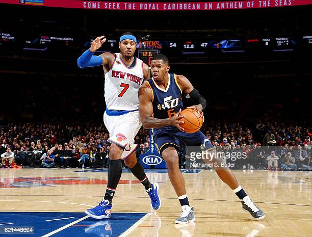 Joe Johnson of the Utah Jazz handles the ball against Carmelo Anthony of the New York Knicks during the game on November 6 2016 at Madison Square...