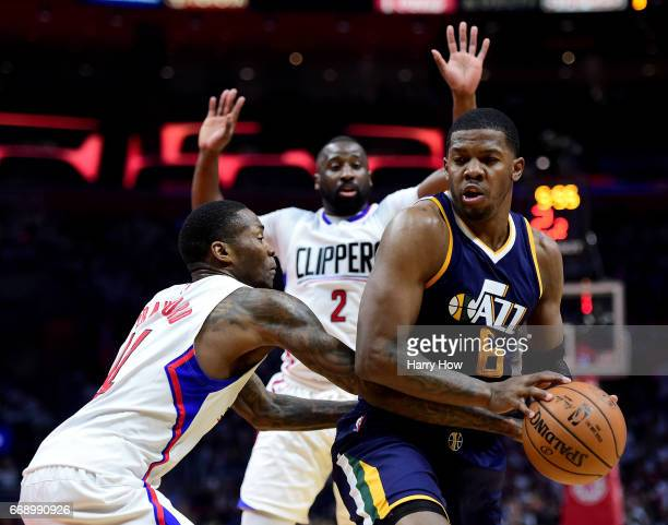 Joe Johnson of the Utah Jazz looks for a shot as he is guarded by Jamal Crawford and Raymond Felton of the LA Clippers during a 9795 Jazz win at...