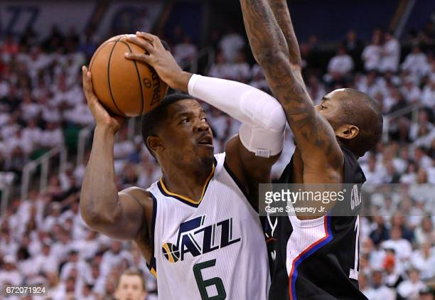 Joe Johnson of the Utah Jazz looks to shoot past the defense of Jamal Crawford of the Los Angeles Clippers in the first half in Game Four of the...