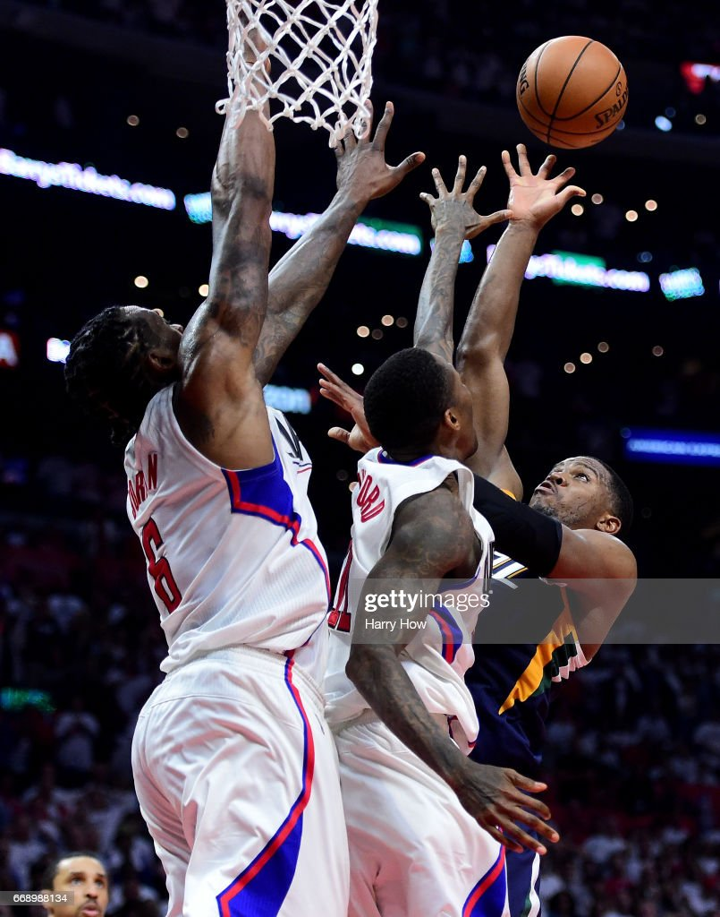 Joe Johnson #6 of the Utah Jazz scores over DeAndre Jordan #6 and Luc Mbah a Moute #12 of the LA Clippers in the final seconds of the game for a win 97-95 win at Staples Center on April 15, 2017 in Los Angeles, California.