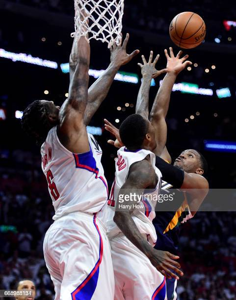 Joe Johnson of the Utah Jazz scores over DeAndre Jordan and Luc Mbah a Moute of the LA Clippers in the final seconds of the game for a win 9795 win...