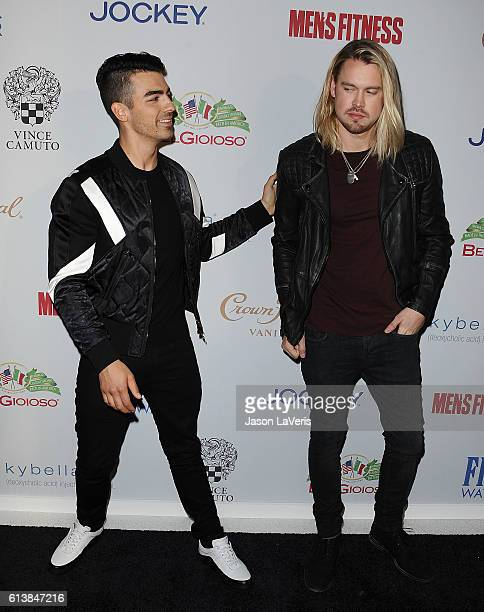 Joe Jonas and Chord Overstreet attend Men's Fitness Game Changers celebration at Sunset Tower Hotel on October 10 2016 in West Hollywood California