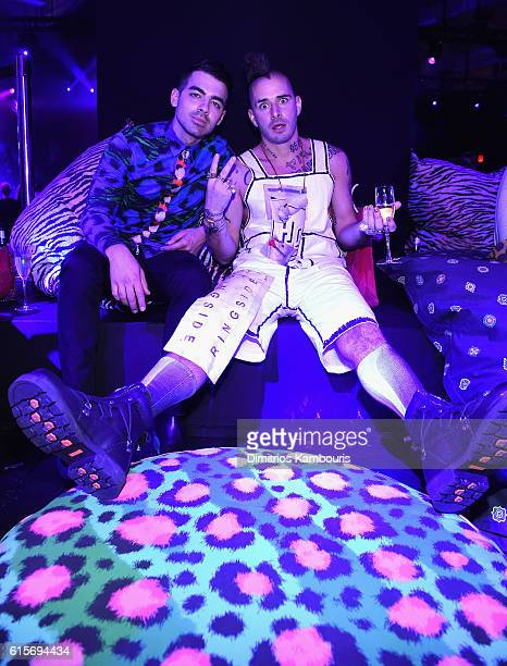 Joe Jonas and Cole Whittle attend the after party at KENZO x HM Launch Event Directed By JeanPaul Goude' at Pier 36 on October 19 2016 in New York...