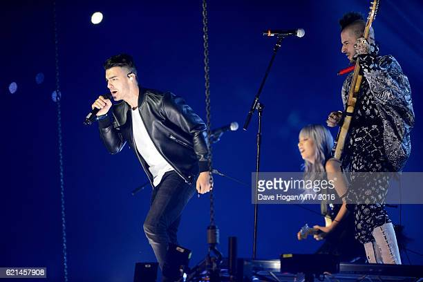 Joe Jonas and Cole Whittle of DNCE perform on stage during the MTV Europe Music Awards 2016 on November 6 2016 in Rotterdam Netherlands