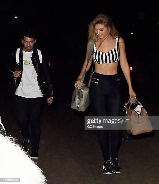 Joe Jonas and Gigi Hadid leave Hyde Park after watching Taylor Swift and Ellie Goulding perform on June 27, 2015 in London, England.