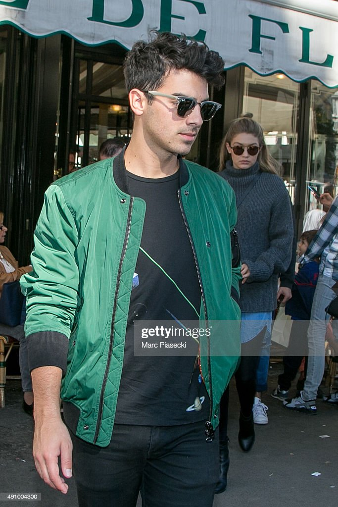 Joe Jonas and Gigi Hadid leave the 'Cafe de Flore' restaurant on October 2, 2015 in Paris, France.