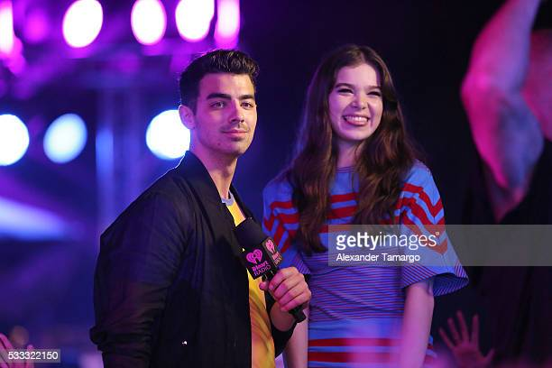 Joe Jonas and Hailee Steinfeld perform on stage during 2016 iHeartRadio Summer Pool Party at Fountainbleau Miami Beach on May 21 2016 in Miami Beach...