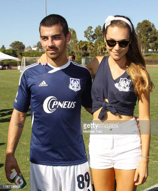 Joe Jonas and his girlfriend, Blanda Eggenschwiler attend The Jonas Brothers host a charity soccer match held at StubHub Center - track and field on...