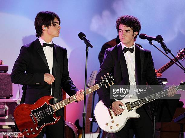 Joe Jonas and Kevin Jonas perform on stage at the 30th Anniversary Carousel Of Hope Ball at The Beverly Hilton Hotel on October 25, 2008 in Beverly...