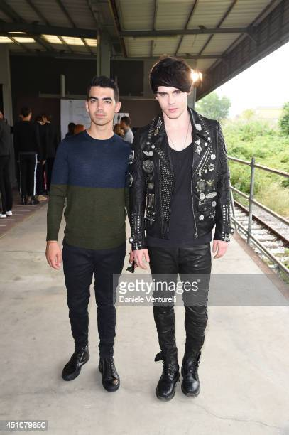 Joe Jonas and Leon Else attend the Diesel Black Gold Show as part of Milan Fashion Week Menswear Spring/Summer 2015 on June 23 2014 in Milan Italy
