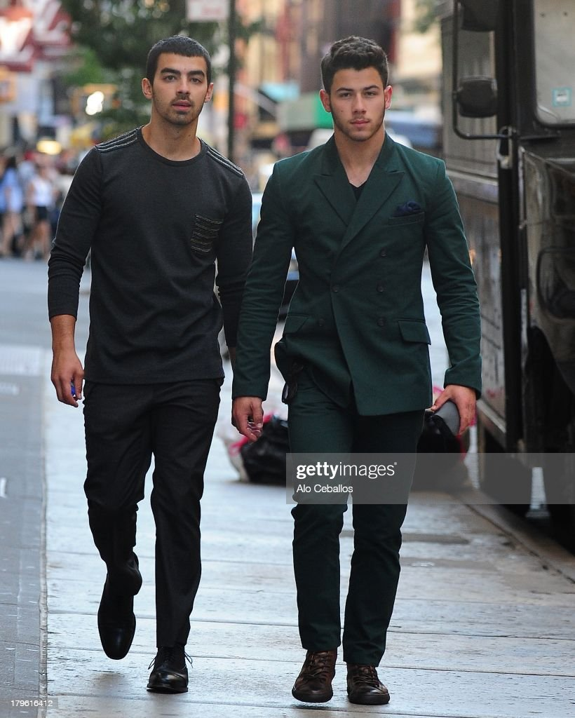 Joe Jonas and Nick Jonas are seen in Soho on September 5, 2013 in New York City.