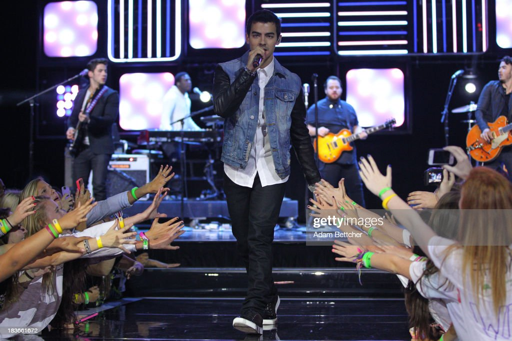 Joe Jonas and the Jonas Brothers perform during the We Day Minnesota event at the Xcel Energy Center in St. Paul, Minnesota on October 8, 2013