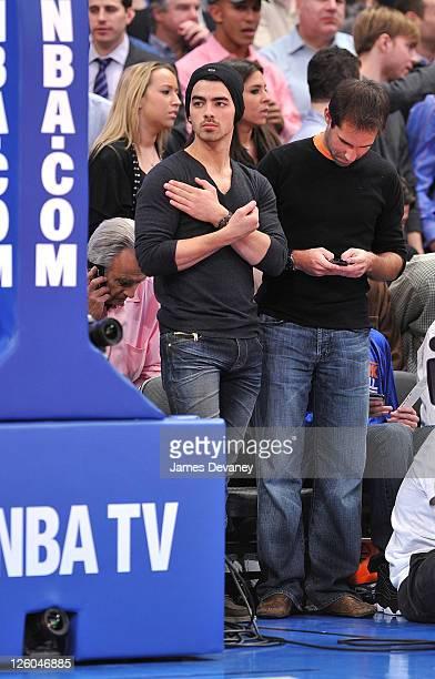 Joe Jonas attends the Miami Heat vs New York Knicks game at Madison Square Garden on December 17 2010 in New York City