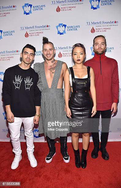Joe Jonas Cole Whittle JinJoo Lee and Jack Lawless of the band DNCE attend TJ Martell Foundation's 41st Annual Honors Gala at Gustavino's on October...
