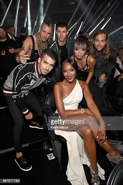 Joe Jonas Cole Whittle Nick Jonas JinJoo Lee Jack Lawless pose with supermodel Naomi Campbell at the 2016 MTV Video Music Awards at Madison Square...