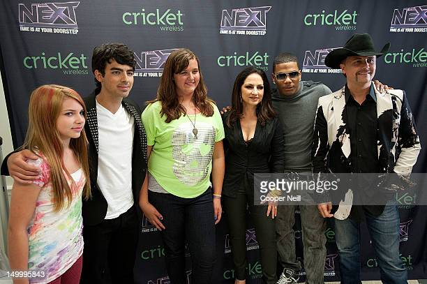 Joe Jonas Gloria Estefan Nelly and John Rich pose for a portrait with fans before a live taping of CW's 'The Next' on August 7 2012 in Dallas Texas