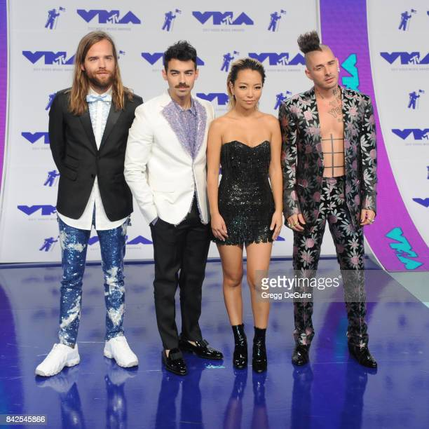 Joe Jonas Jack Lawless Cole Whittle and JinJoo Lee of DNCE arrive at the 2017 MTV Video Music Awards at The Forum on August 27 2017 in Inglewood...