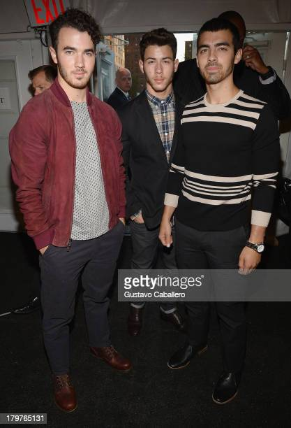 Joe Jonas Kevin Jonas and Nick Jonas of Jonas Brothers is seen around Lincoln Center Day 2 MercedesBenz Fashion Week Spring 2014 at Lincoln Center...
