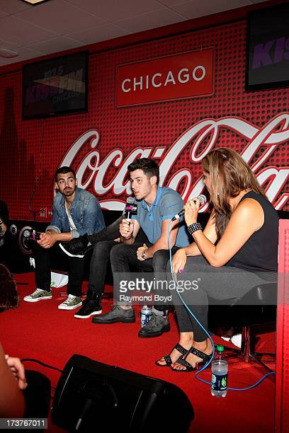 Joe Jonas Kevin Jonas and Nick Jonas of The Jonas Brothers are interviewed by onair personality Angi Taylor in the KISSFM 'CocaCola Lounge' in...