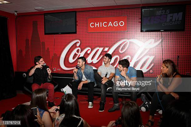 Joe Jonas Kevin Jonas and Nick Jonas of The Jonas Brothers are interviewed by onair personalities Special K and Angi Taylor in the KISSFM 'CocaCola...